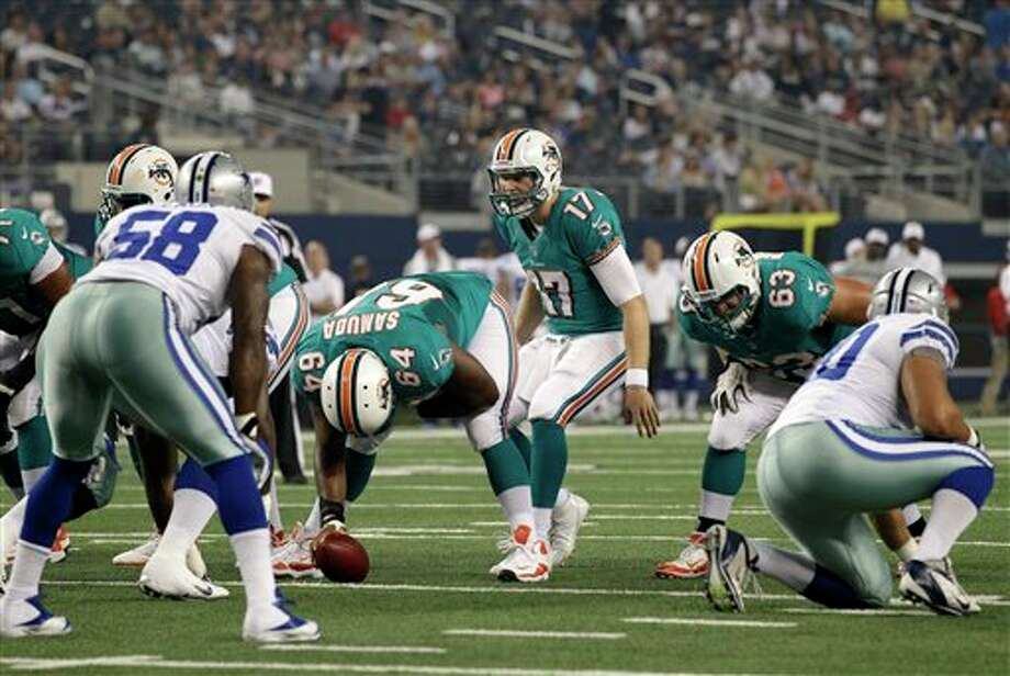Miami Dolphins quarterback Ryan Tannehill (17) instructs his team at the line of scrimmage in the first half of a preseason NFL football game against the Dallas Cowboys Wednesday, Aug. 29, 2012, in Arlington, Texas. (AP Photo/Tony Gutierrez) Photo: Tony Gutierrez, Associated Press / AP