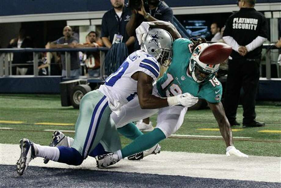 Dallas Cowboys cornerback Teddy Williams (20) breaks up a pass intended for Miami Dolphins' Legedu Naanee (19) in the end zone in the first half of a preseason NFL football game Wednesday, Aug. 29, 2012, in Arlington, Texas. (AP Photo/Tony Gutierrez) Photo: Tony Gutierrez, Associated Press / AP
