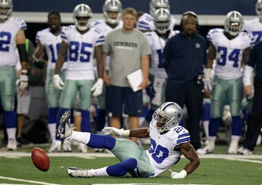 Dallas Cowboys cornerback Teddy Williams (20) drops a potential interception in the first half of a preseason NFL football game against the Miami Dolphins Wednesday, Aug. 29, 2012, in Arlington, Texas. (AP Photo/LM Otero) Photo: LM Otero, Associated Press / AP