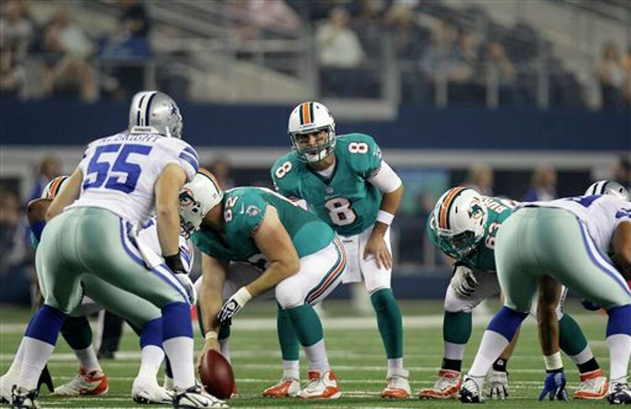 Miami Dolphins quarterback Matt Moore (8) instructs his team at the line of scrimmage in the first half of a preseason NFL football game against the Dallas Cowboys Wednesday, Aug. 29, 2012, in Arlington, Texas. (AP Photo/LM Otero) Photo: LM Otero, Associated Press / AP