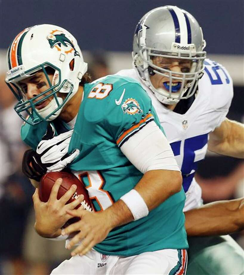 Miami Dolphins quarterback Matt Moore (8) is sacked by Dallas Cowboys linebacker Alex Albright (55) during the first half of a preseason NFL football game, Wednesday, Aug. 29, 2012, in Arlington, Texas. (AP Photo/Sharon Ellman) Photo: Sharon Ellman, Associated Press / FR170032 AP
