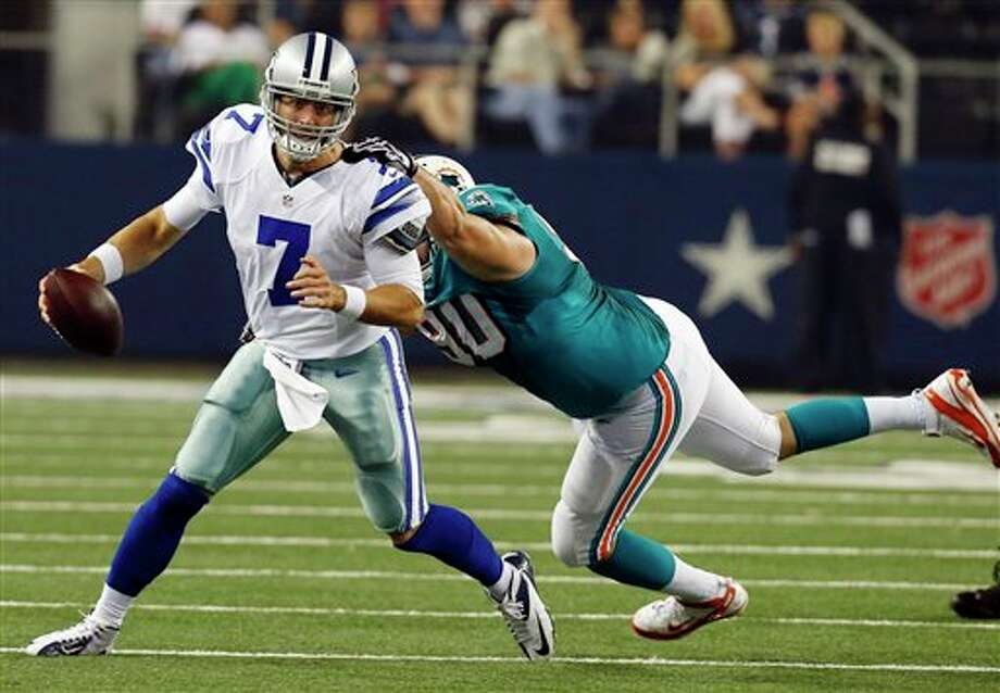 Miami Dolphins defensive end Ryan Baker (90) misses tackling Dallas Cowboys quarterback Stephen McGee (7) during the first half of a preseason NFL football game, Wednesday, Aug. 29, 2012, in Arlington, Texas. (AP Photo/Sharon Ellman) Photo: Sharon Ellman, Associated Press / FR170032 AP