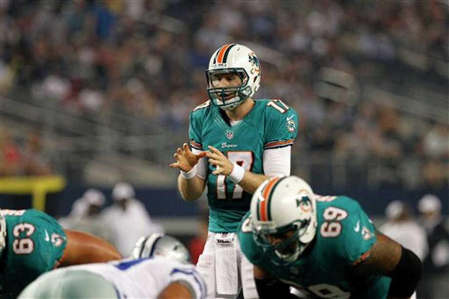 Miami Dolphins' Ryan Tannehill (17) at the line of scrimmage in the first half of a preseason NFL football game against the Dallas Cowboys Wednesday, Aug. 29, 2012, in Arlington, Texas. (AP Photo/Tony Gutierrez) Photo: Tony Gutierrez, Associated Press / AP