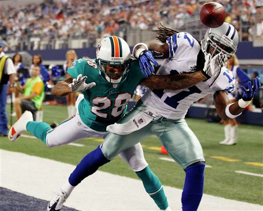 Miami Dolphins defensive back Nolan Carroll (28) breaks up a pass to Dallas Cowboys wide receiver Dwayne Harris (17) during the first half of a preseason NFL football game, Wednesday, Aug. 29, 2012, in Arlington, Texas. (AP Photo/LM Otero) Photo: LM Otero, Associated Press / AP