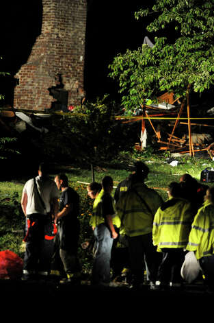 At 6:42 p.m. New Milford authorities were called to the scene of an explosion at a Sunny Valley Road residence on Wednesday, Aug. 29, 2012. New Milford police say one person is confirmed dead and two others, including a child, were taken to Danbury Hospital with severe injuries. Photo: Jason Rearick / The News-Times