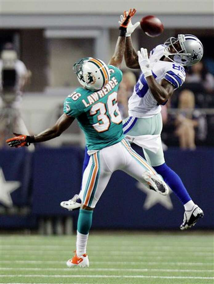 Dallas Cowboys wide receiver Kevin Ogletree (85) misses a reception as Miami Dolphins defensive back Quinten Lawrence (36) defends during the first half of a preseason NFL football game, Wednesday, Aug. 29, 2012, in Arlington, Texas. (AP Photo/LM Otero) Photo: LM Otero, Associated Press / AP