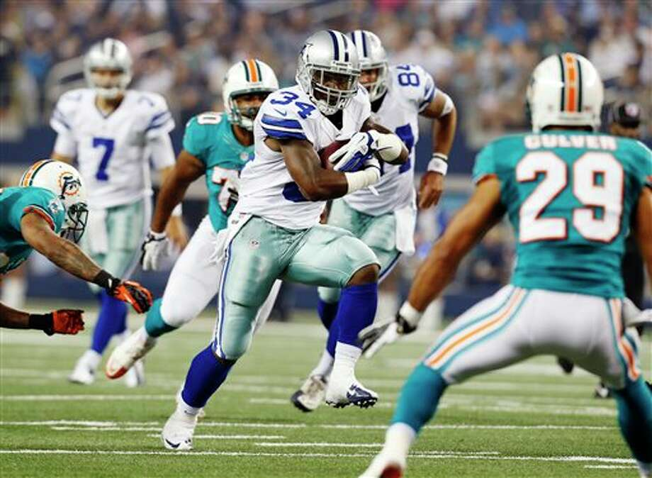 Dallas Cowboys running back Phillip Tanner (34) takes the ball down field against the Miami Dolphins during the first half of a preseason NFL football game, Wednesday, Aug. 29, 2012, in Arlington, Texas. (AP Photo/Sharon Ellman) Photo: Sharon Ellman, Associated Press / FR170032 AP
