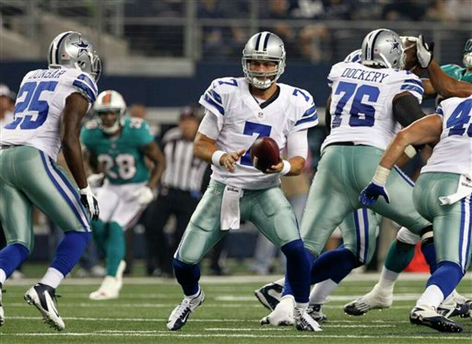 Dallas Cowboys quarterback Stephen McGee (7) drops back to hand off to Lance Dunbar (25) in the first half of a preseason NFL football game against the Miami Dolphins Wednesday, Aug. 29, 2012, in Arlington, Texas. (AP Photo/Tony Gutierrez) Photo: Tony Gutierrez, Associated Press / AP