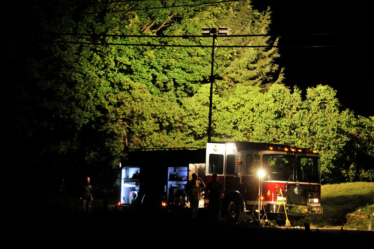 At 6:42 p.m. New Milford authorities were called to the scene of an explosion at a Sunny Valley Road residence on Wednesday, Aug. 29, 2012. New Milford police say one person is confirmed dead and two others, including a child, were taken to Danbury Hospital with severe injuries.