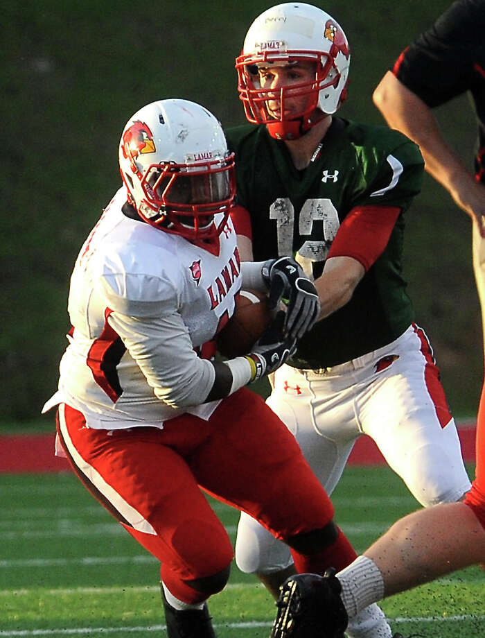 Caleb Berry hands off to Depauldrick Garrett during the Crawfish Bowl Spring game at Lamar University in Beaumont, Tuesday,  April 17, 2012. Tammy McKinley/The Enterprise Photo: TAMMY MCKINLEY