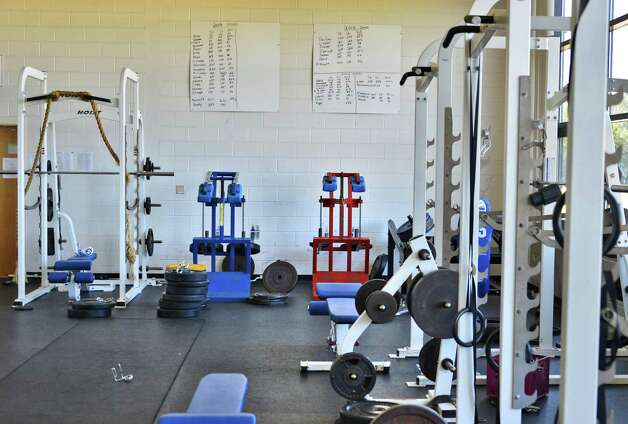 The weight room at  Queensbury High School Wednesday Aug. 29, 2012.  A 16-year-old Queensbury High School football player died from an unidentified infection Tuesday.  (John Carl D'Annibale / Times Union) Photo: John Carl D'Annibale / 00019057A