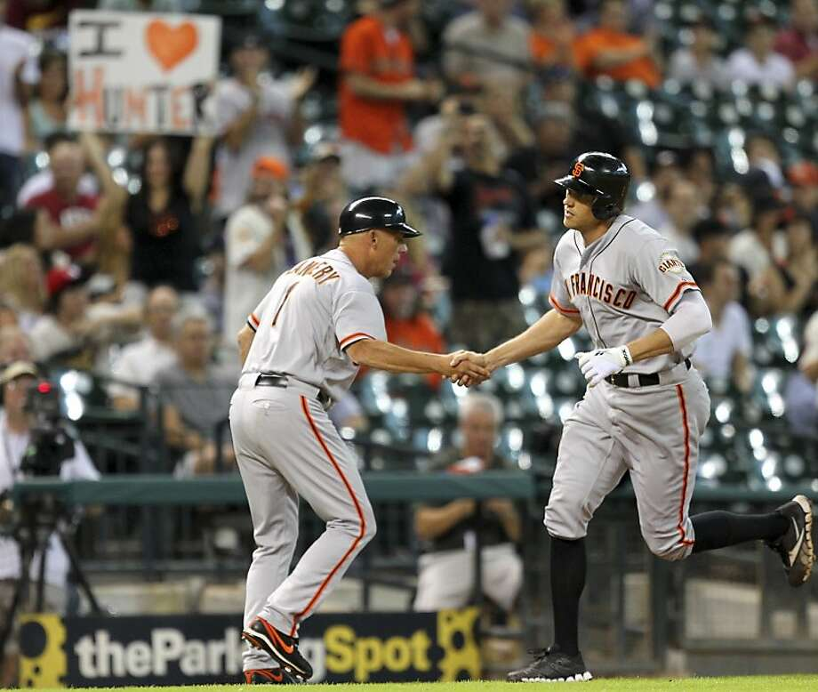 Hunter Pence's three-run home run helped stake the Giants to a 4-0 lead that was quickly in danger. Photo: Bob Levey, Getty Images