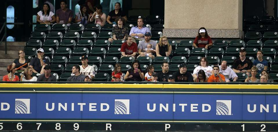 A thin crowd watches from the Crawford Boxes during the first inning. (Karen Warren / Houston Chroni