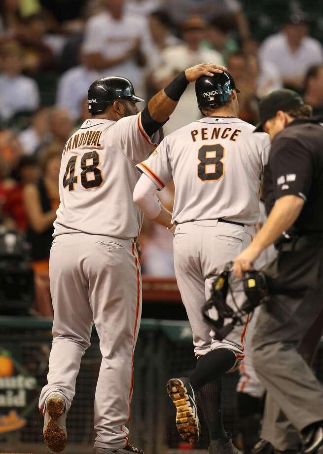 Giants right fielder Hunter Pence (8) is congratulated by San Francisco Giants third baseman Pablo Sandoval (48). (Karen Warren / Houston Chronicle)
