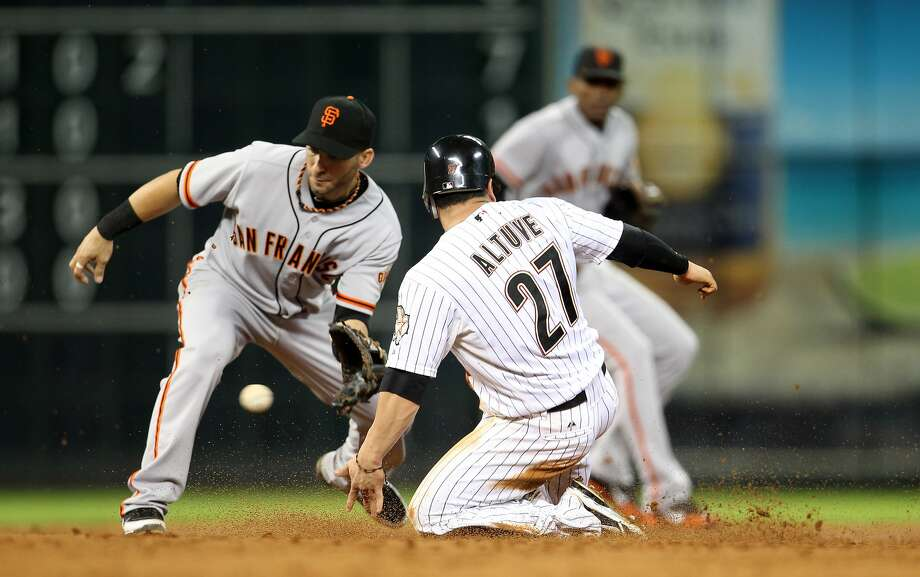 Astros second baseman Jose Altuve (27) steals second base from Giants third baseman Marco Scutaro. (Karen Warren / Houston Chronicle)