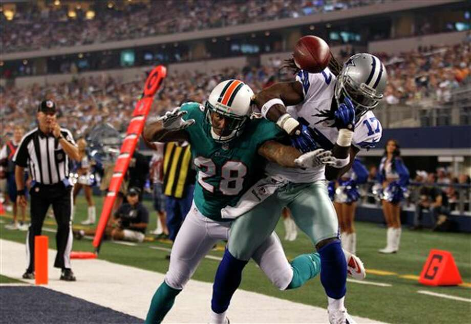 Miami Dolphins defensive back Nolan Carroll (28) breaks up a pass intended for Dallas Cowboys' Dwayne Harris (17) in the first half of a preseason NFL football game Wednesday, Aug. 29, 2012, in Arlington, Texas. (AP Photo/LM Otero) Photo: LM Otero, Associated Press / AP