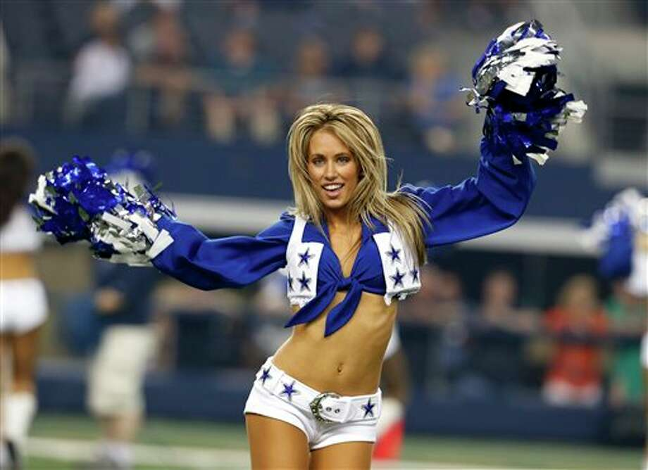 A member of the Dallas Cowboys cheerleaders performs in the first half of a preseason NFL football game against the Miami Dolphins Wednesday, Aug. 29, 2012, in Arlington, Texas. (AP Photo/Sharon Ellman) Photo: Sharon Ellman, Associated Press / FR170032 AP
