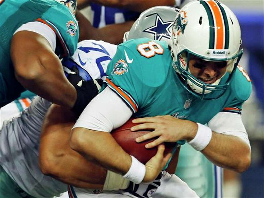 Miami Dolphins quarterback Matt Moore (8) is sacked by Dallas Cowboys tackle Jeff Adams (70) during the second half of a preseason NFL football game, Wednesday, Aug. 29, 2012, in Arlington, Texas. (AP Photo/Sharon Ellman) Photo: Sharon Ellman, Associated Press / FR170032 AP