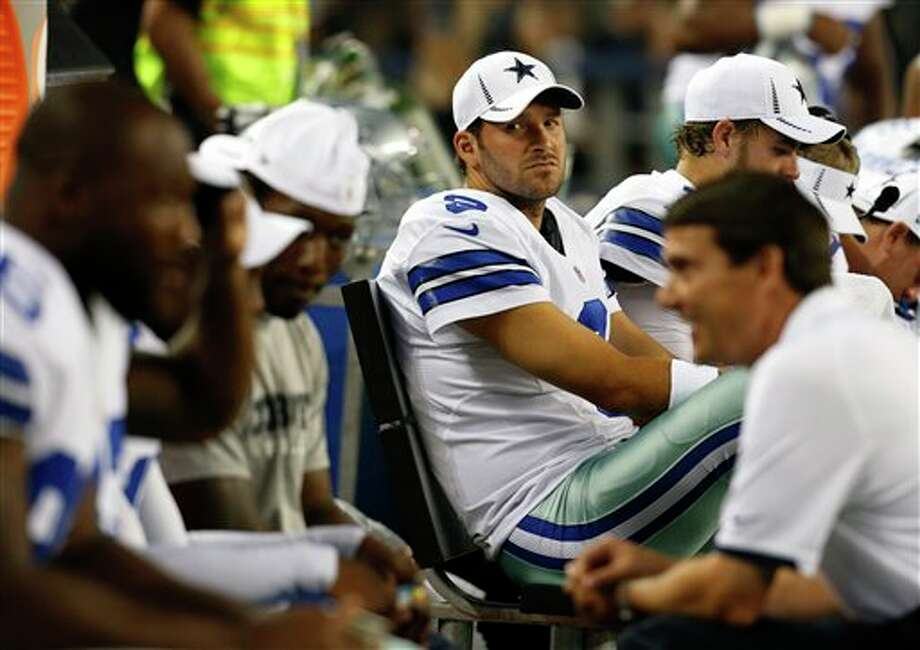 Dallas Cowboys' Tony Romo (9) on the bench in the first half of a preseason NFL football game against the Miami Dolphins Wednesday, Aug. 29, 2012, in Arlington, Texas. (AP Photo/Sharon Ellman) Photo: Sharon Ellman, Associated Press / FR170032 AP
