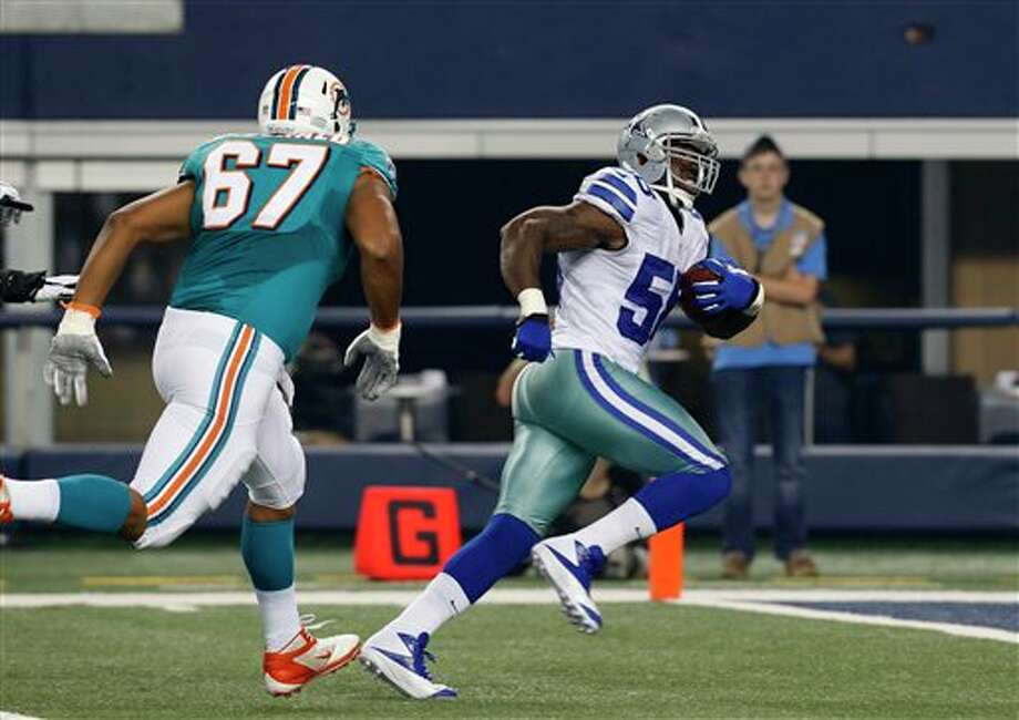 Miami Dolphins tackle Andrew McDonald (67) gives chase as Dallas Cowboys' Orie Lemon (58) runs a interception in for a touchdown in the first half of a preseason NFL football game Wednesday, Aug. 29, 2012, in Arlington, Texas. (AP Photo/Sharon Ellman) Photo: Sharon Ellman, Associated Press / FR170032 AP