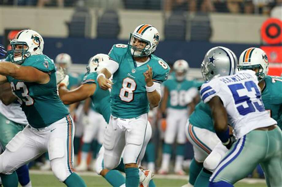 Miami Dolphins quarterback Matt Moore (8) passes against the Dallas Cowboys half of a preseason NFL football game Wednesday, Aug. 29, 2012, in Arlington, Texas. (AP Photo/Sharon Ellman) Photo: Sharon Ellman, Associated Press / FR170032 AP