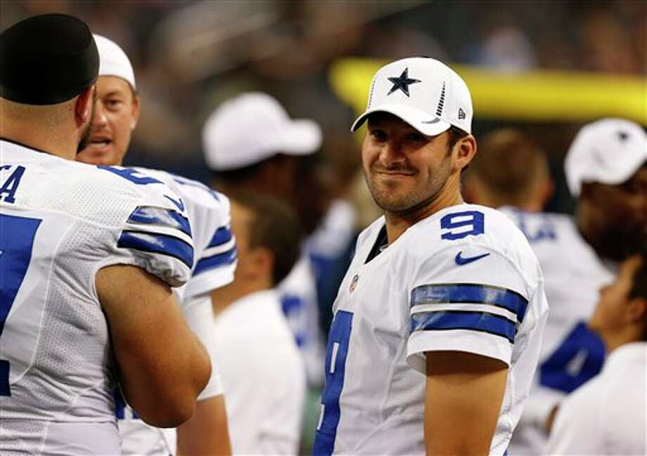 Dallas Cowboys' Tony Romo (9) on the sideline during the first half of a preseason NFL football game against the Miami Dolphins Wednesday, Aug. 29, 2012, in Arlington, Texas. (AP Photo/Sharon Ellman) Photo: Sharon Ellman, Associated Press / FR170032 AP