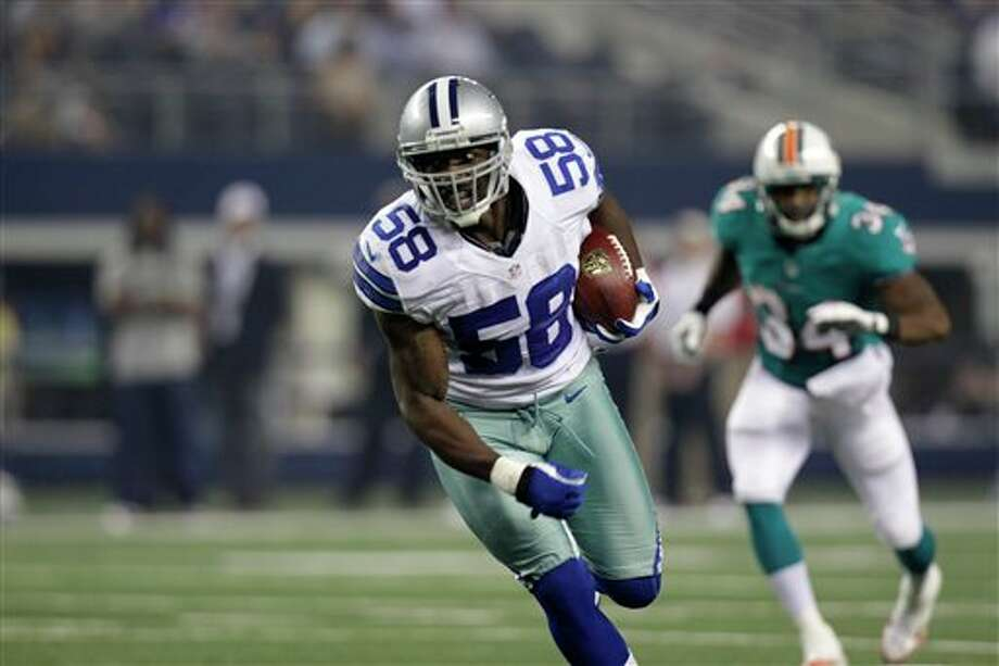 Dallas Cowboys linebacker Orie Lemon (58) runs back an interception for a touchdown against the Miami Dolphins  half of a preseason NFL football game Wednesday, Aug. 29, 2012, in Arlington, Texas. (AP Photo/LM Otero) Photo: LM Otero, Associated Press / AP