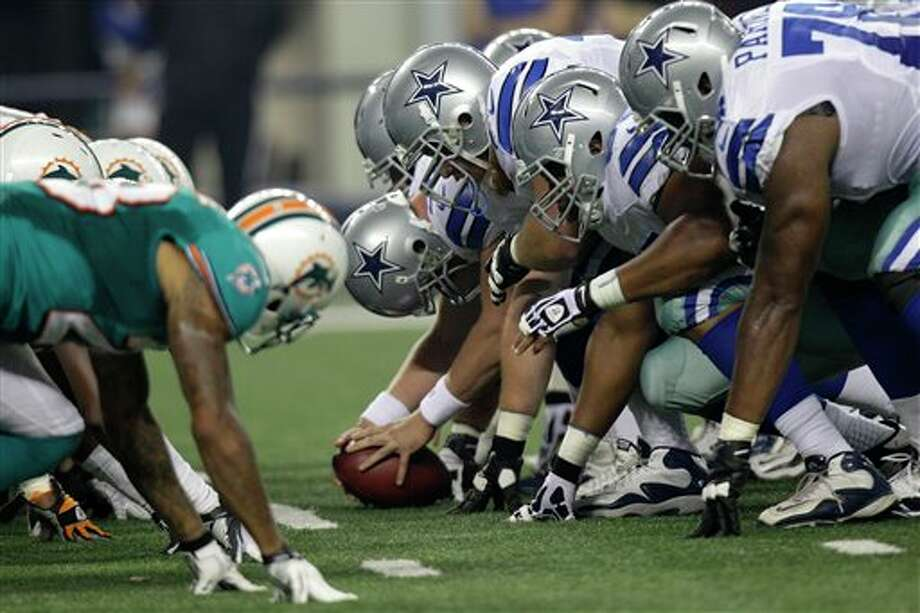 The Miami Dolphins and Dallas Cowboys in the first half of a preseason NFL football game Wednesday, Aug. 29, 2012, in Arlington, Texas. (AP Photo/LM Otero) Photo: LM Otero, Associated Press / AP
