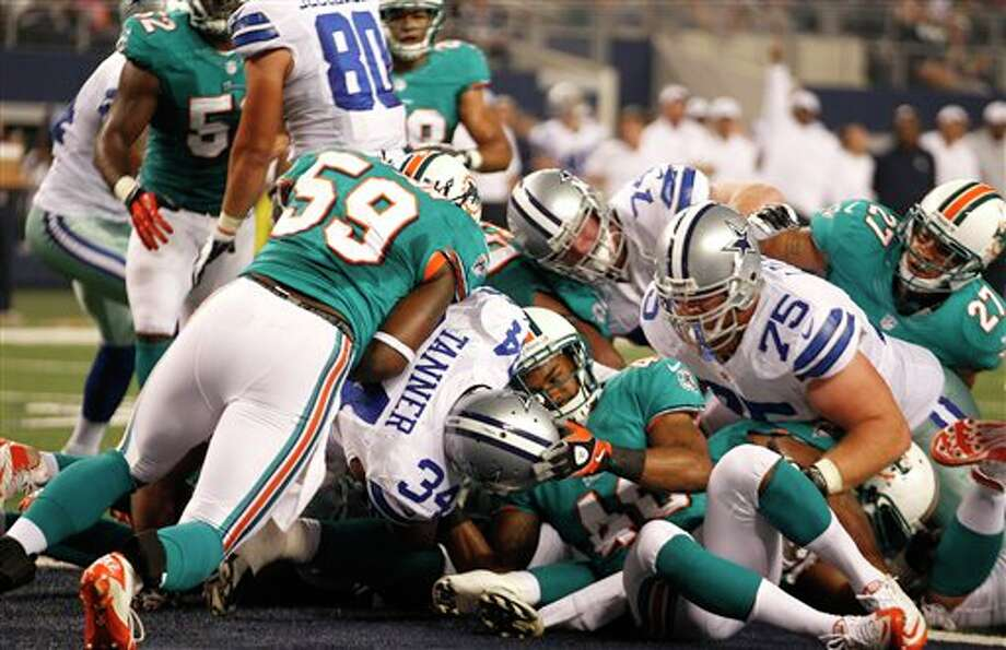 Dallas Cowboys running back Phillip Tanner (34) scores a touchdown in the first half of a preseason NFL football game against the Miami Dolphins Wednesday, Aug. 29, 2012, in Arlington, Texas. (AP Photo/LM Otero) Photo: LM Otero, Associated Press / AP