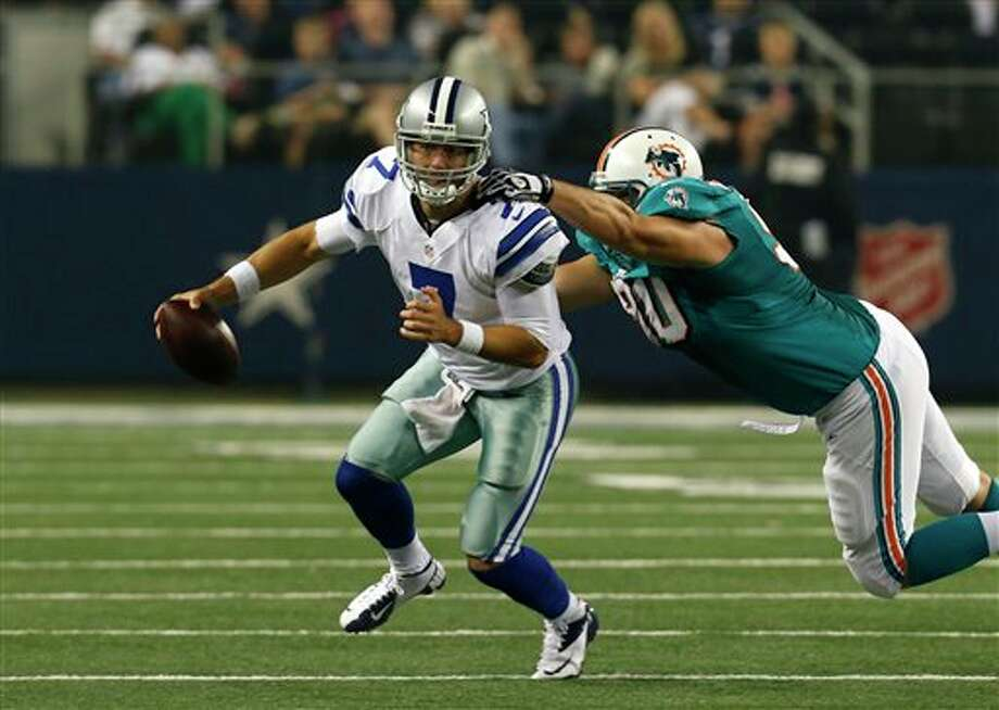 Dallas Cowboys' Stephen McGee (7) is pressured by Miami Dolphins defensive end Ryan Baker in the first half of a preseason NFL football game Wednesday, Aug. 29, 2012, in Arlington, Texas. (AP Photo/Sharon Ellman) Photo: Sharon Ellman, Associated Press / FR170032 AP