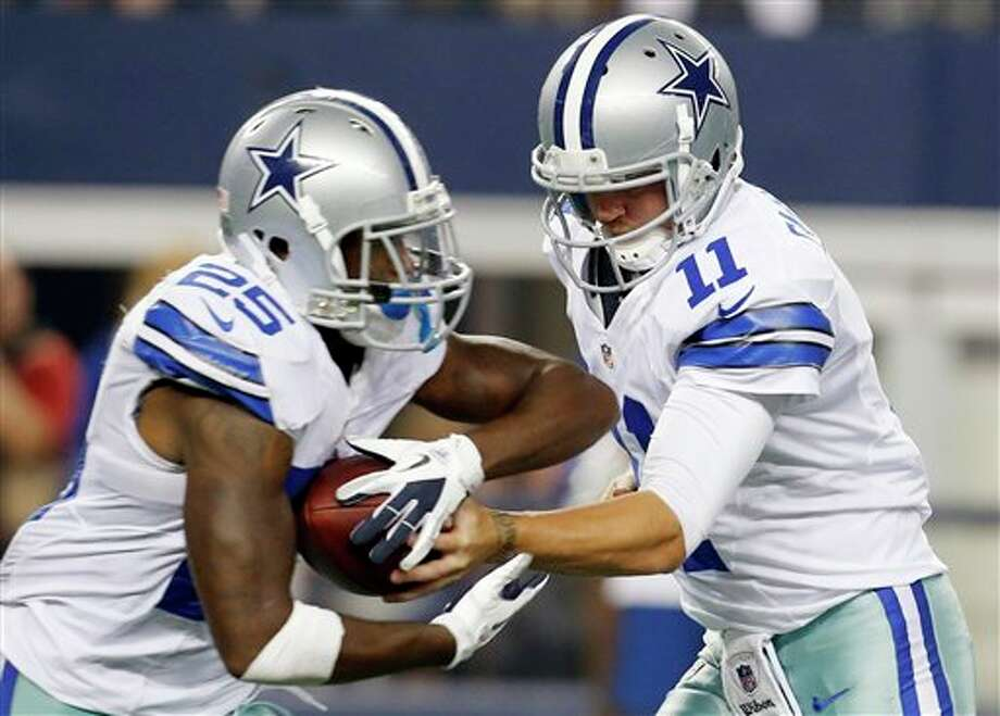 Dallas Cowboys quarterback Rudy Carpenter (11) hands the ball to running back Lance Dunbar (25) during the second half of a preseason NFL football game against the Miami Dolphins, Wednesday, Aug. 29, 2012, in Arlington, Texas. (AP Photo/Sharon Ellman) Photo: Sharon Ellman, Associated Press / FR170032 AP