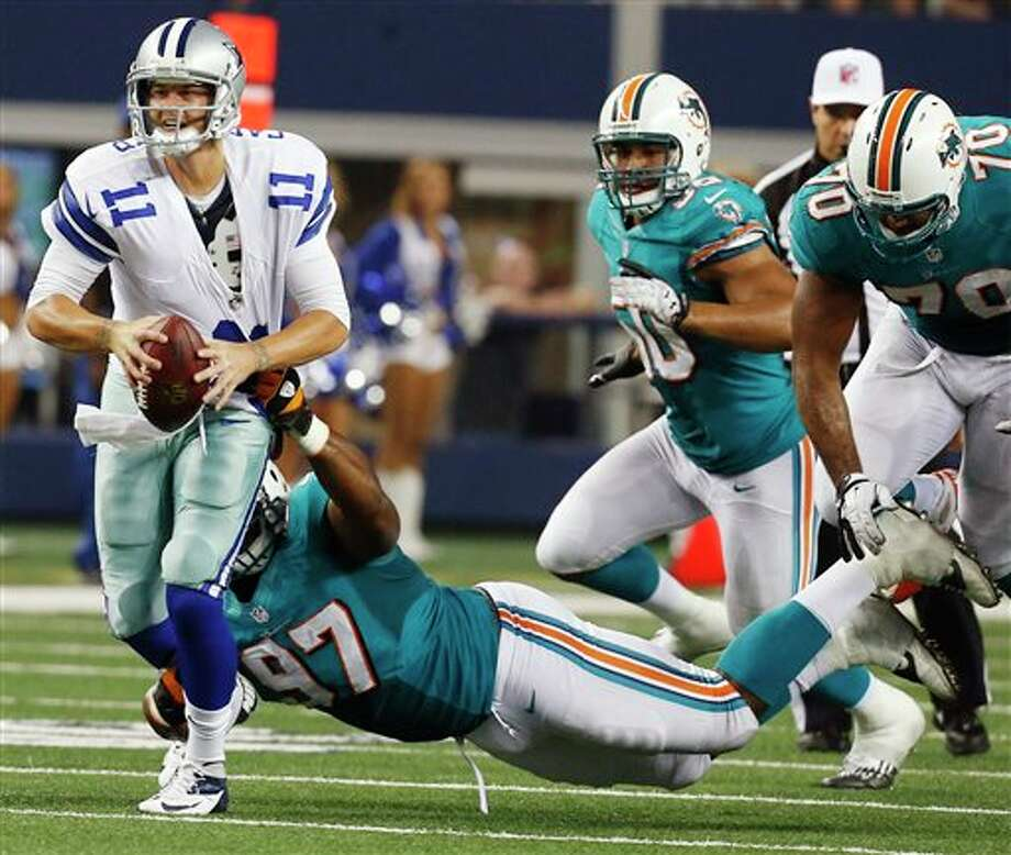 Dallas Cowboys quarterback Rudy Carpenter (11) is tackled by Miami Dolphins defensive tackle Kheeston Randall (97) during the second half of a preseason NFL football game, Wednesday, Aug. 29, 2012, in Arlington, Texas. (AP Photo/Sharon Ellman) Photo: Sharon Ellman, Associated Press / FR170032 AP