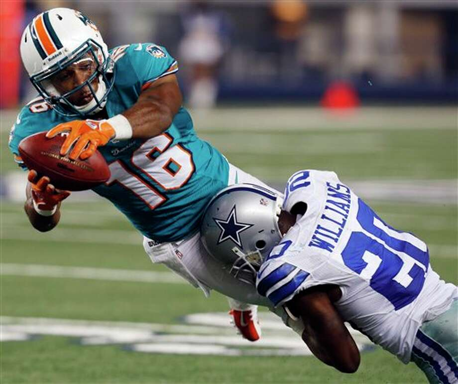 Miami Dolphins wide receiver B.J. Cunningham (16) is tackled by Dallas Cowboys cornerback Teddy Williams (20) during the second half of a preseason NFL football game, Wednesday, Aug. 29, 2012, in Arlington, Texas. (AP Photo/Sharon Ellman) Photo: Sharon Ellman, Associated Press / FR170032 AP