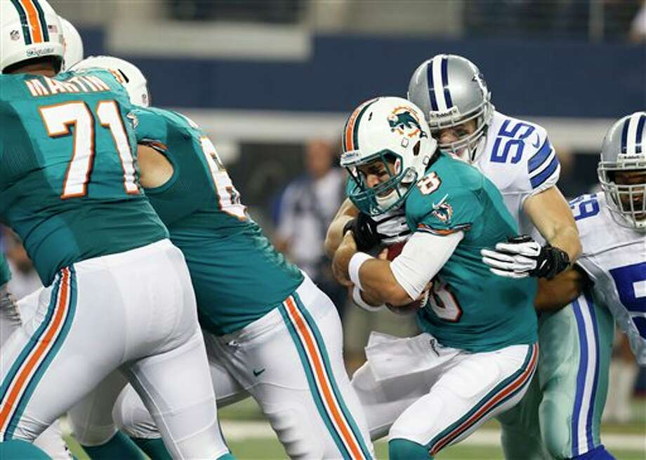 Miami Dolphins quarterback Matt Moore (8) is sacked by Dallas Cowboys' Alex Albright (55) in the first half of a preseason NFL football game Wednesday, Aug. 29, 2012, in Arlington, Texas. (AP Photo/Sharon Ellman) Photo: Sharon Ellman, Associated Press / FR170032 AP