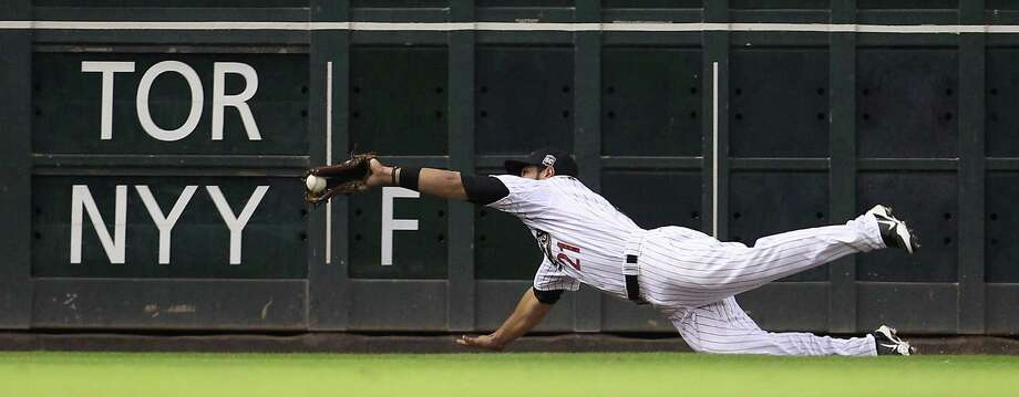 Astros left fielder Fernando Martinez gets his glove on a ball hit by the Giants' Joaquin Arias but can't hold on, allowing Arias to end up with a triple in the sixth. Photo: Karen Warren / © 2012  Houston Chronicle