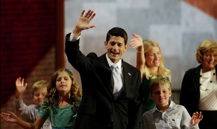 Republican vice presidential nominee, Rep. Paul Ryan waves with his family, from left, Sam, Liza, wife Janna, Charlie and mother Betty Ryan Douglas after his acceptance speech during the Republican National Convention in Tampa, Fla., on Wednesday, Aug. 29, 2012. (AP Photo/Charlie Neibergall) Photo: Charlie Neibergall / AP