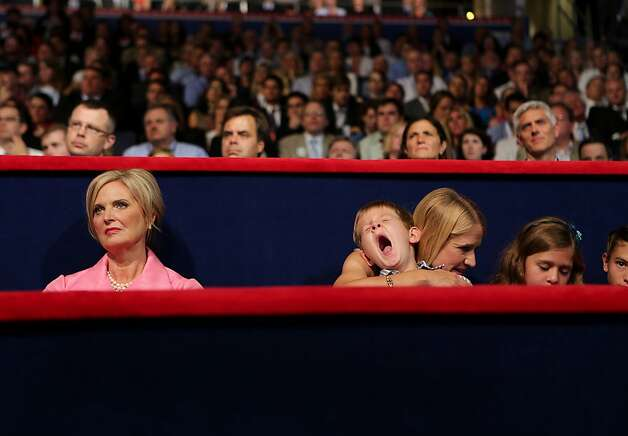 Ann Romney, wife of Republican presidential candidate Mitt Romney, left, sits with Janna Ryan, wife of Republican vice presidential candidate Paul Ryan, as she holds her yawning son Sam Ryan at the Republican National Convention (RNC) in Tampa, Florida, U.S., on Wednesday, Aug. 29, 2012. Representative Paul Ryan takes the stage tonight to address the RNC with a dual mission: to provide a spark, along with his big ideas about cutting the budget, to energize the party's base. Photographer: Scott Eells/Bloomberg *** Local Caption *** Ann Romney; Janna Ryan; Sam Ryan Photo: Scott Eells, Bloomberg