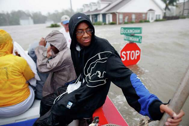 LAPLACE, LA - AUGUST 29:  Christopher Smith rides in a boat after being rescued from the rising flood water from Hurricane Isaac in the River Forest subdivision on August 29, 2012 in LaPlace, Louisiana. The large Level 1 hurricane slowly moved across southeast Louisiana, dumping huge amounts of rain and knocking out power to Louisianans in scattered parts of the state. (Photo by Chris Graythen/Getty Images) ***BESTPIX*** Photo: Chris Graythen, Getty Images / 2012 Getty Images