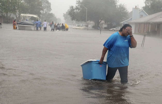 Residents of the  Cambridge Neighborhood  in LaPlace Louisiana Wednesday Aug. 29, 2012 evacuate their neighborhood. The state sent scores of buses and dozens of high-water vehicles to help evacuate about 3,000 people from St. John the Baptist Parish after Tropical Storm Isaac pushed water from lakes Pontchartrain and Maurepas into parts of LaPlace. (AP Photo/Arthur D. Lauck, The Advocate) Photo: Arthur D. Lauck, Associated Press / The Advocate