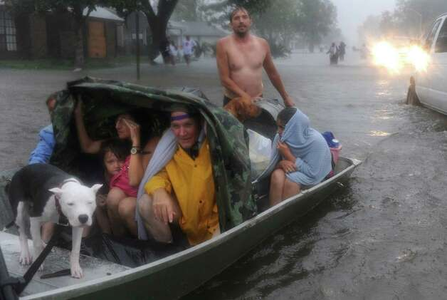 Residents of the Cambridge Neighborhood of LaPlace Louisiana flee rising flood waters associated with Hurricane Isaac Wednesday Aug. 29, 2012. The state sent scores of buses and dozens of high-water vehicles to help evacuate about 3,000 people from St. John the Baptist Parish after Tropical Storm Isaac pushed water from lakes Pontchartrain and Maurepas into parts of LaPlace. Photo: Arthur D. Lauck, The Advocate