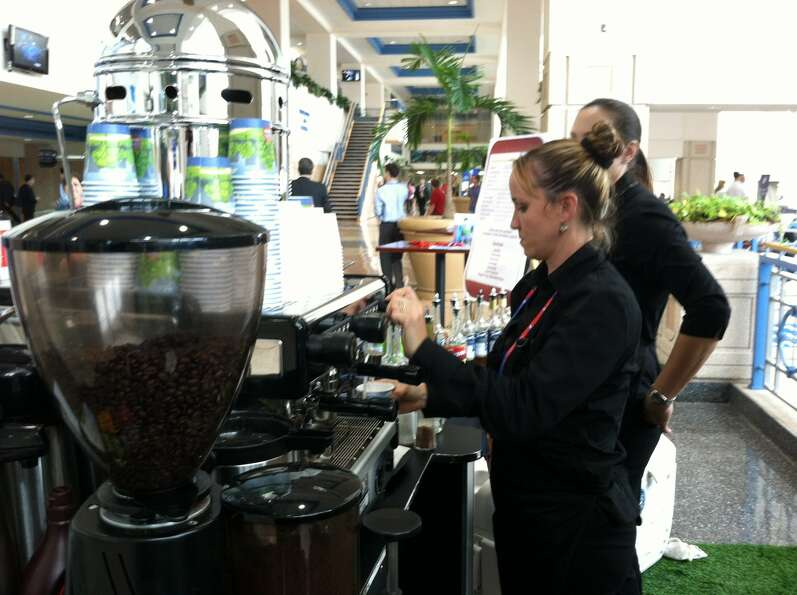 Baristas serve espresso-based drinks and other beverages to delegates and reporters at the Republica