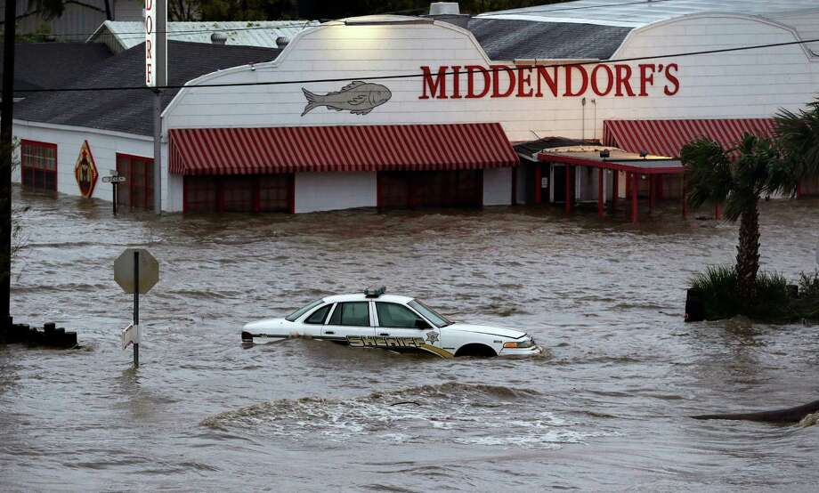 A sherriff's vehicle sits in flood waters caused by Isaac, Thursday, Aug. 30, 2012, north of LaPlace, La, off Lake Pontchartrain. Isaac's maximum sustained winds had decreased to 45 mph and the National Hurricane Center said it was expected to become a tropical depression by Thursday night. The storm's center was on track to cross Arkansas on Friday and southern Missouri on Friday night, spreading rain as it goes.  (AP Photo/Eric Gay) Photo: Eric Gay, Associated Press / AP