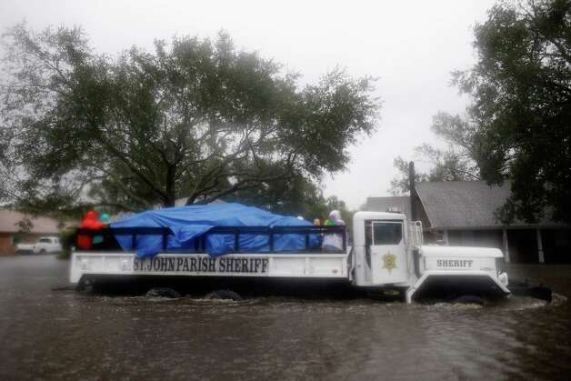 LAPLACE, LA - AUGUST 29:  St. John Parish Sherriff officials rescue local residents from the flood waters of Hurricane Isaac in the River Forest subdivision on August 29, 2012 in LaPlace, Louisiana. The large Level 1 hurricane slowly moved across southeast Louisiana, dumping huge amounts of rain and knocking out power to Louisianans in scattered parts of the state. Photo: Chris Graythen, Getty Images / 2012 Getty Images