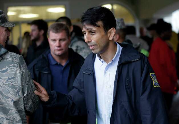 Louisiana Gov. Bobby Jindal visits volunteers, media, and residents as the Riverbend Nursing Center is evacuated, Wednesday, Aug. 29, 2012, in Jesuit Bend, La. Plaquemines Parish ordered a mandatory evacuation for the west bank of the Mississippi below Belle Chasse because of worries about a storm surge. The order affected about 3,000 people, including residents of the nursing home. (AP Photo/Eric Gay) Photo: Eric Gay, Associated Press / AP
