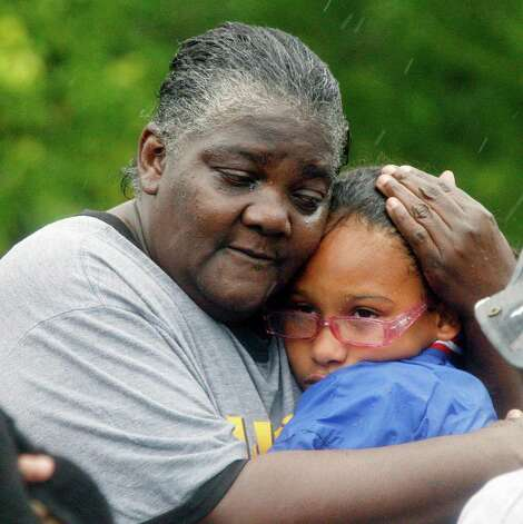 Danessa Lee, left, comforts her granddaughter Ashanti Lee, 12, after their family was rescued in Pearlington, Miss., by law enforcement officers and first responders using boats, Wednesday, Aug. 29, 2012, during the nonstop rain from Isaac. A number of residents of the small community were trapped by the rising waters and had be rescued or waited until the low tide when waters receded so they could walk out. (AP Photo/Rogelio V. Solis) Photo: Rogelio V. Solis, Associated Press / AP