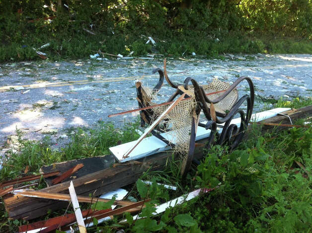 Debris from a home on Sunny Valley Road in New Milford, Conn., where an explosion Wednesday, Aug. 29, 2012 killed 47-year-old Anthony Fratino of New Milford, also critically injuring Fratino's nine-year-old son Nicholas and the owner of the home, 46-year-old John Wilkinson. Fratino and his son had come to help Wilkinson after Wilkinson arrived home to the smell of gas about 6:30 Wednesday evening. Photo: Michael Duffy