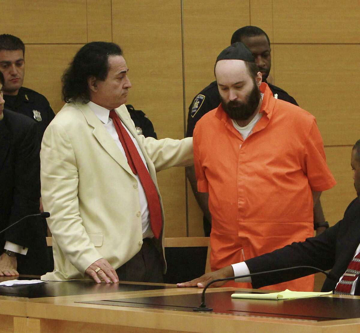 Defense attorney Howard Greenberg, left, comforts his client, Levi Aron, right, before Aron was escorted from the courtroom after sentencing at State Supreme Court in the Brooklyn borough of New York, Wednesday, Aug. 29, 2012. Aron received 40 years to life in prison for the 2011 murder of eight-year-old Leiby Kletzky, who he abducted after the child stopped to ask him for directions while walking home from religious day camp.