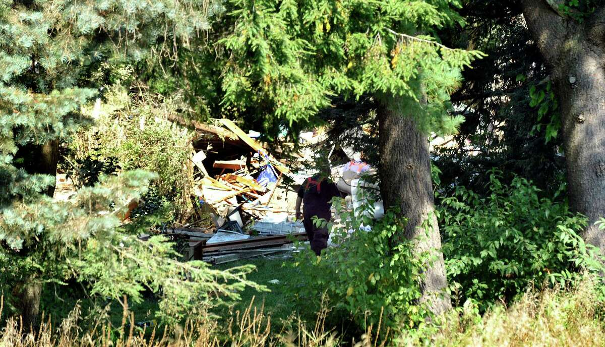 This is a view of the Sunny Valley Road house that exploded in New Milford seen from the neighbor's yard. Photographed Thursday, Aug. 30, 2012.