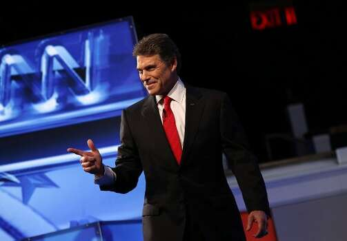 Texas Gov. Rick Perry is introduced prior to a debate at Constitution Hall November 22, 2011 in Washington, DC. (Win McNamee / Getty)