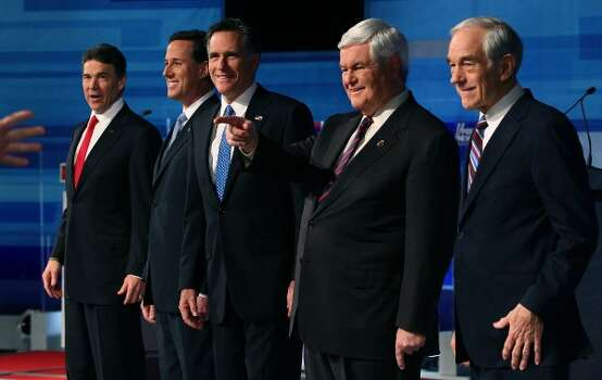 Rick Perry, Rick Santorum, Mitt Romney, Newt Gingrich, and Ron Paul pose for a photos before participating in a Fox News, Wall Street Journal sponsored debate at the Myrtle Beach Convention Center, on January 16, 2012 in Myrtle Beach, S.C. (Mark Wilson / Getty Images)
